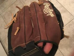Brown and black Rawlings softball glove