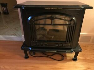 Black electric fireplace with remote.