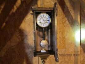 MECHANICAL WALL CLOCKS, WITH KEYS GOING GOOD.