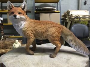 Red fox realistic animal statue with pup