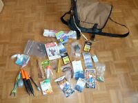 Fishing starter kit including 3 rods, 2 reels, 1 bag, multiple packs of lures, weights, hooks, etc.