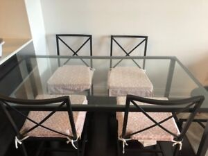 Table with 4 chairs and pink cushions