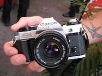 Canon AE-1 Program SLR 35mm Film camera with 50mm F1.8 Lens.