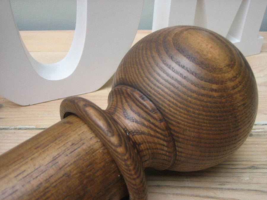 How to Care for a Wood Curtain Pole