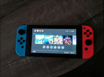 Nintendo Switch Neon in great condition (with multiple games)