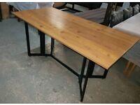 A brand new desinger side folding dining table.