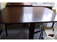 Dark wood gate leg table with decorative edging