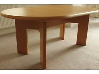 A Skovby, oak veneer, extending oval dining table,12 years old, unmarked and is as new .