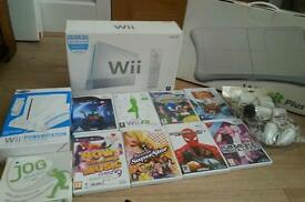 Nintendo wii complete console with wii fit board wii wheel Nintendo wii stand and 8 games