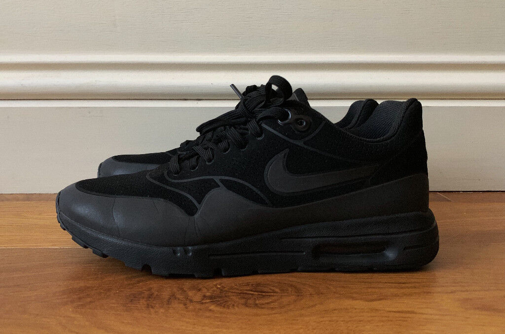 new style e3c57 392bb Nike Air Max 1 Ultra Moire Triple Black Women s Shoes Trainers