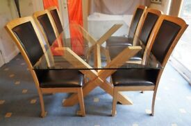 Scandinavian style glass topped dining table and six chairs