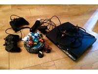 PlayStation 3 with 20 games and extras.