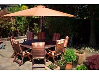 Large octagonal solid hardwood table and chairs