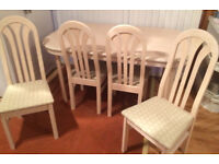 4 seater dining table and free rug