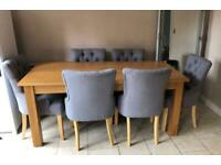 Dining table and 6 grey chairs excellent condition