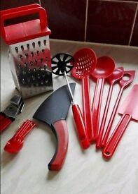 Bundle of matching red kitchen utensils