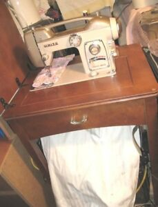 Heavy duty Vintage White Sewing Machine with Pedal in wood table