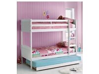 White wooden bunk bed with trundle