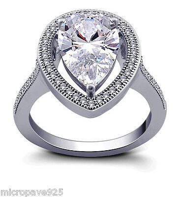 Sterling Silver 925 Pear Shaped Solitaire Ring with Pave Set Cubic -