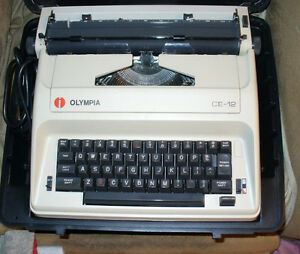 Olympia CE 12 electric typewriter, portable model working