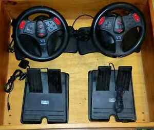 2 x PS2 steering wheels with pedals