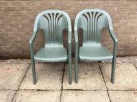 Pair of green garden chairs
