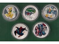 A SELECTION OF FIVE SILVER PLATED COINS, PLUTO,SUPERMAN,DONALD DUCK,SPIDERMAN & CAPT.AMERICA