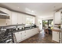Recently decorated four double bedroom house with a private garden in Parsons Green.