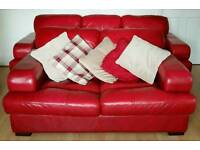 One Reid Furniture deep red red leather 2 seater sofa couch suite with cushions - Fire compliant