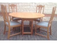 Solid oak table with 4 chairs . REDUCED FOR QUICK SALE