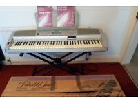 Yamaha DGX 300 portable touch-sensitive 76 key digital piano, with stand, adaptor & manual