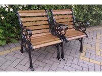 A MATCHING PAIR OF SOLID CAST IRON CHAIRS IN GREEN OR BLACK FOR A GARDEN, PATIO OR CONSERVATORY