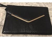 Large black clutch bag
