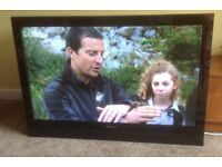 """42"""" Warfdale flat screen TV with remote control and wall fixings. Can be seen working."""