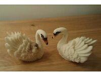 Three swan figurines