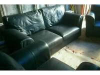 Black leather sofa and 2 chair's excellent condition