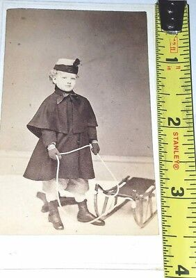 C.D.V. photo with little girl child and her sled