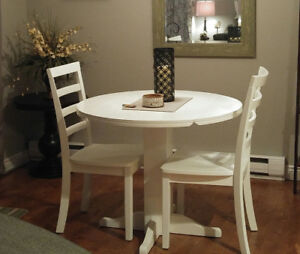 White round table and two chairs