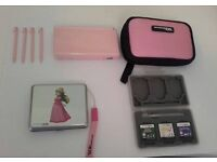 Pink Nintendo DS Lite and Charger and 4 Pink DS Pens and DS Holder and 2 Games Holders