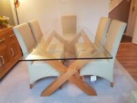 Bentley Designs Lyon Glass Dining Table + 6 ivory wing back dining chairs