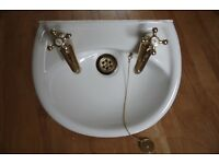 Cloakroom basin with taps
