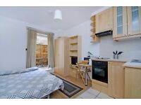Great MODERN FURNISHED studio flat with open plan kitchen, en-suite shower/wc and PRIVATE PATIO