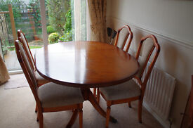 Yew reproduction dining table and 4 chairs.
