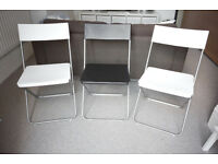 3 x IKEA JEFF folding stackable chairs (2x white, 1x black)