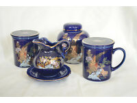 Tea set with two mugs including sieve, tea container and milk can with coaster, blue china