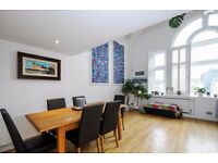 A stunning two bedroom split level loft apartment