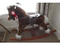 Rocking horse with saddle and stirrups. Ideal for nursery. Good clean condition.