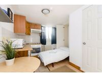 SINGLE Studio flat with open plan kitchen and en-suite shower/wc. FREE WIFI and SKY TV.