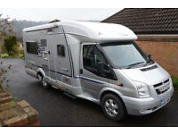 Hymer Tramp T652 CL - Very good condition throughout. Dark blue upholstery and light honey woodwork.
