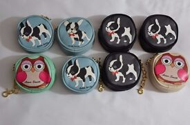 New selection of 8 assorted cute animal coin purses. Great for gifts.